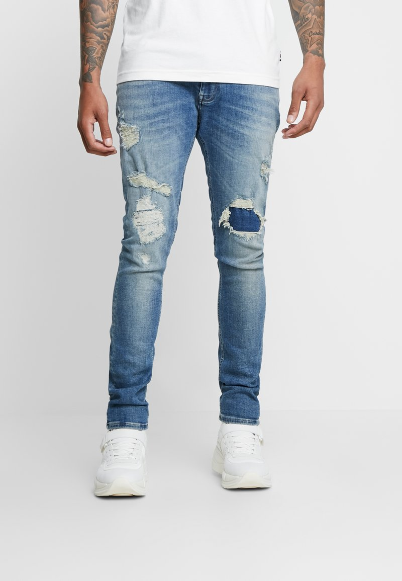 Tommy Hilfiger - LEWIS HAMILTON RIP AND REPAIR  - Slim fit jeans - denim