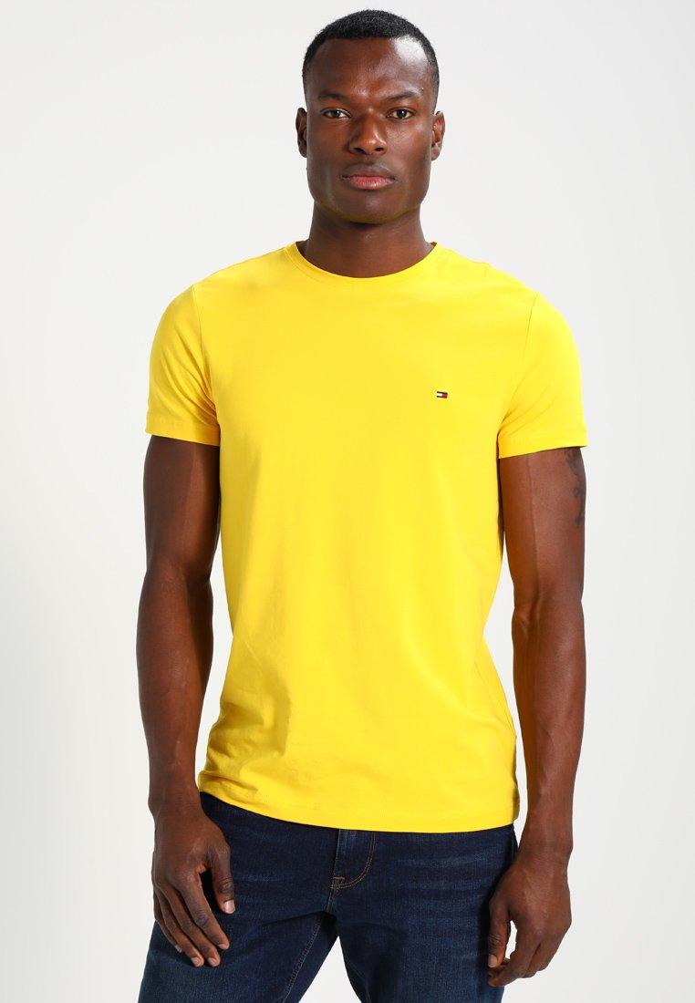 Tommy Hilfiger - STRETCH SLIM FIT TEE - Camiseta estampada - yellow