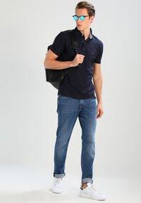 Tommy Hilfiger - PERFORMANCE REGULAR FIT - Poloskjorter - blue - 1