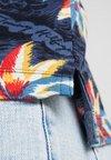Tommy Hilfiger - ALLOVER FLOWER SLIM POLO - Poloshirt - blue