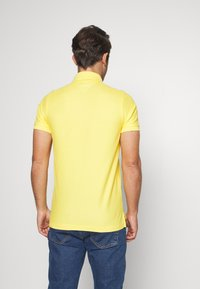 Tommy Hilfiger - HILFIGER SLIM POLO - Piké - yellow - 2