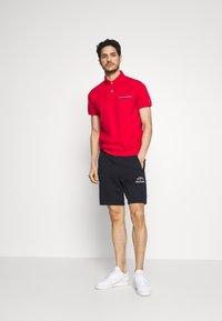 Tommy Hilfiger - POCKET DETAIL SLIM POLO - Polo shirt - red - 1