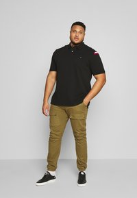Tommy Hilfiger - SHOULDER INSERT - Poloshirt - black - 1