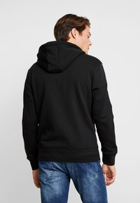 Tommy Hilfiger - LEWIS HAMILTON LEECE SWEAT ZIP THRU - Mikina na zip - black - 2