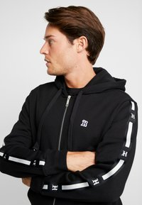 Tommy Hilfiger - LEWIS HAMILTON LEECE SWEAT ZIP THRU - Mikina na zip - black - 3