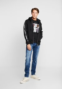 Tommy Hilfiger - LEWIS HAMILTON LEECE SWEAT ZIP THRU - Mikina na zip - black - 1