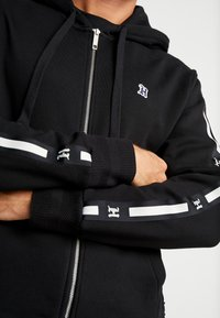 Tommy Hilfiger - LEWIS HAMILTON LEECE SWEAT ZIP THRU - Mikina na zip - black - 5