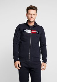 Tommy Hilfiger - FLOCKED ZIP THROUGH - Mikina na zip - blue - 0