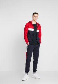 Tommy Hilfiger - COLORBLOCKED HOODED ZIP THROUGH - Mikina na zip - red - 1