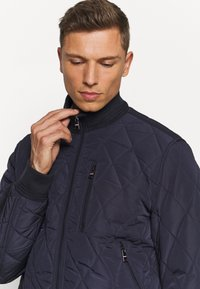 Tommy Hilfiger - DIAMOND QUILTED BOMBER - Light jacket - blue - 3