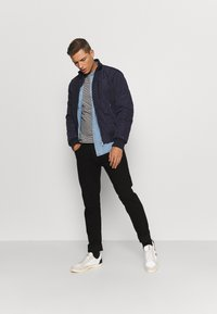 Tommy Hilfiger - DIAMOND QUILTED BOMBER - Light jacket - blue - 1