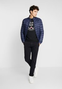 Tommy Hilfiger - LIGHT WEIGHT PADDED - Välikausitakki - blue - 1