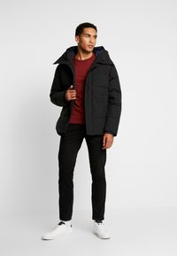 Tommy Hilfiger - HEAVY BOMBER - Winter jacket - black - 1