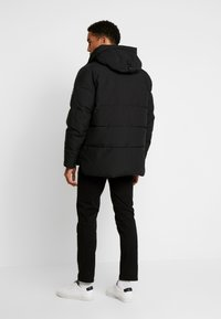 Tommy Hilfiger - HEAVY BOMBER - Winter jacket - black - 2