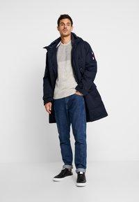 Tommy Hilfiger - MONOGRAM HOODED - Winter coat - blue - 1