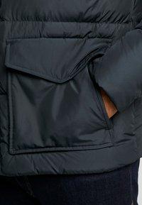 Tommy Hilfiger - HOODED BOMBER - Gewatteerde jas - black - 6