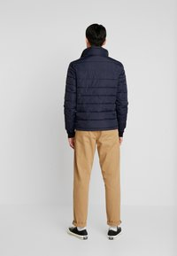 Tommy Hilfiger - QUILTED HOODED JACKET - Light jacket - blue - 3
