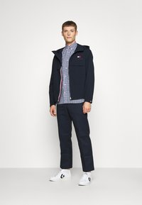 Tommy Hilfiger - HOODED JACKET - Waterproof jacket - blue - 1