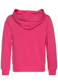 Tommy Hilfiger - GRAPHIC ON GRAPHIC ZIP THROUGH - Zip-up hoodie - pink - 1