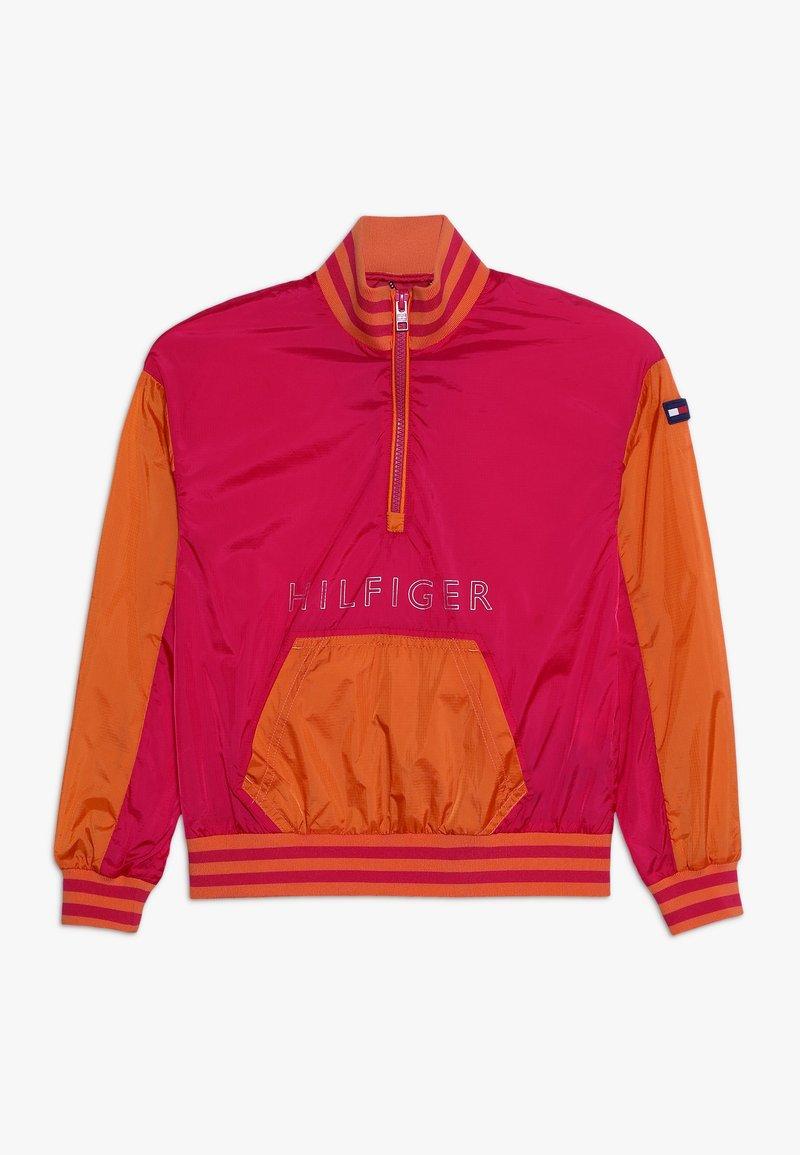 Tommy Hilfiger - UNLINED LIGHT POPOVER - Lehká bunda - red