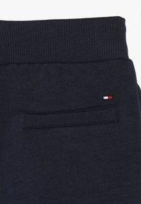 Tommy Hilfiger - FLAG INTERLOCK PANTS - Tracksuit bottoms - blue - 4