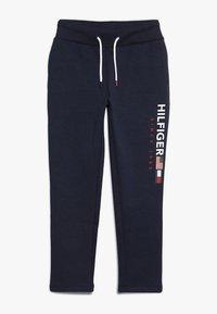 Tommy Hilfiger - FLAG INTERLOCK PANTS - Tracksuit bottoms - blue - 0