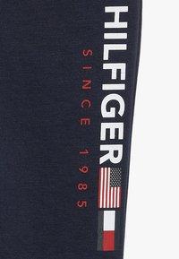 Tommy Hilfiger - FLAG INTERLOCK PANTS - Tracksuit bottoms - blue - 2