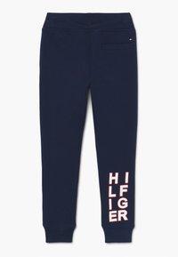 Tommy Hilfiger - GRAPHIC - Pantalon de survêtement - blue - 1