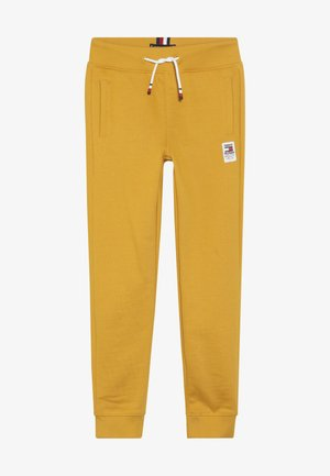 ESSENTIAL SOLID - Tracksuit bottoms - yellow