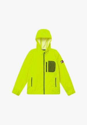 COMBI HOODED - Vodotěsná bunda - yellow