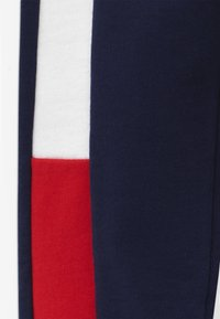 Tommy Hilfiger - FLAG - Tracksuit bottoms - blue - 3