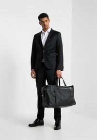 Tommy Hilfiger - COATED DUFFLE - Weekend bag - black - 1