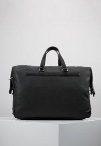 Tommy Hilfiger - COATED DUFFLE - Weekend bag - black - 2
