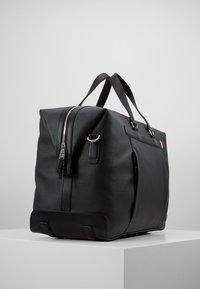 Tommy Hilfiger - COATED DUFFLE - Weekend bag - black - 3