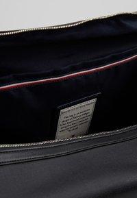 Tommy Hilfiger - COATED DUFFLE - Weekend bag - black - 4