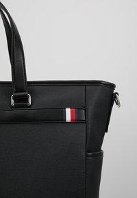 Tommy Hilfiger - COATED TOTE - Tote bag - black - 6
