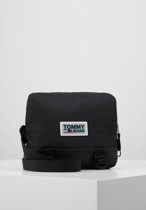 URBAN VARSITY BODY BAG - Heuptas - black