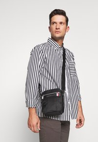 Tommy Hilfiger - ELEVATED NYLON MINI REPORTER - Torba na ramię - black - 1