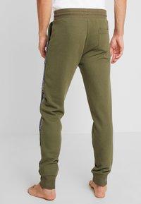 Tommy Hilfiger - TRACK PANT - Bas de pyjama - green - 2