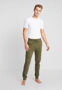 Tommy Hilfiger - TRACK PANT - Bas de pyjama - green - 1