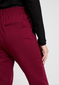 TOM TAILOR - PANTS ANKLE - Pantalones deportivos - tile red - 3