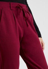 TOM TAILOR - PANTS ANKLE - Pantalones deportivos - tile red - 5