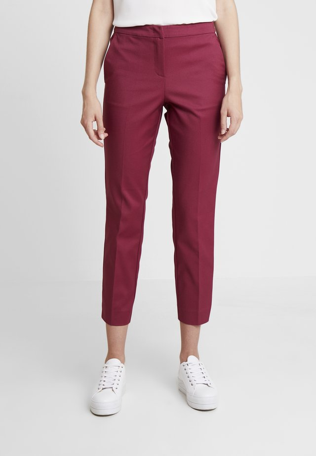 MIA SLIM - Trousers - tile red