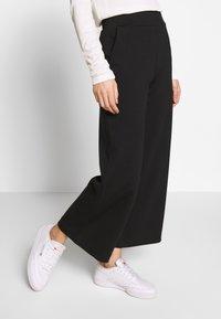 TOM TAILOR - WIDE LEG PANTS - Spodnie materiałowe - deep black - 2