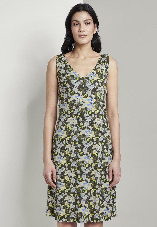Jerseyjurk - small khaki floral design