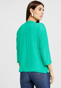 TOM TAILOR - FABRIC MIX - Pullover - light simply green