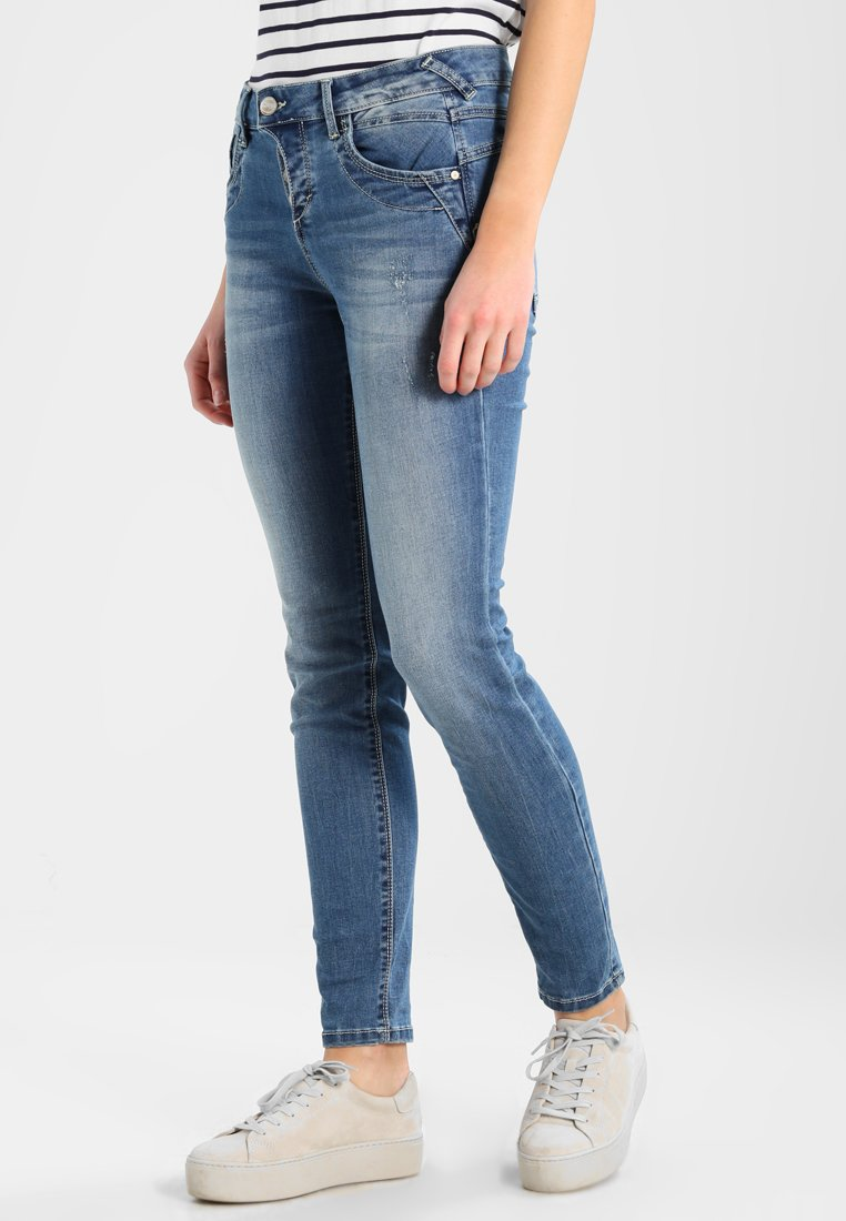 TOM TAILOR - RELAXED TAPERED PANTS  - Jeans Relaxed Fit - mid stone wash denim