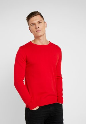 Stickad tröja - red melange