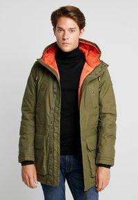 TOM TAILOR - Winter coat - olive drap green - 0
