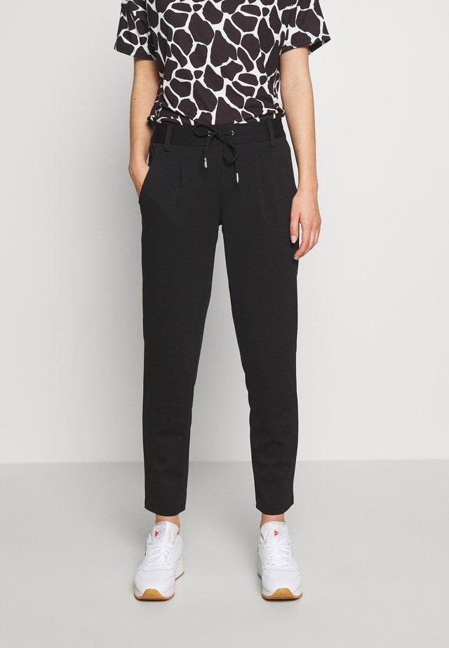 KNITTED TRACK PANTS - Spodnie materiałowe - deep black